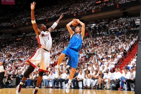 Hi-res-115947636-dirk-nowitzki-of-the-dallas-mavericks-shoots-over-chris_crop_exact_medium