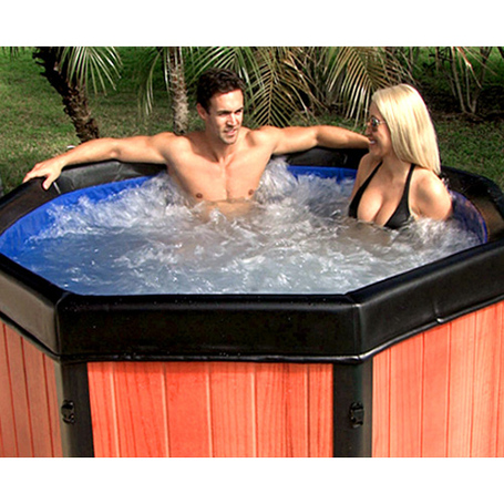 A man and woman sitting in the Spa-N-A-Box portable spa