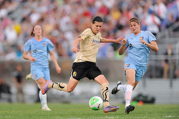 FC Gold Pride's Christine Sinclair takes a shot as Brittany Taylor of Sky Blue FC defends. Photo: Howard C. Smith, isiphotos.com