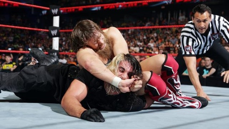 Seth-rollins-and-roman-reigns-defeated-randy-orton-and-daniel-bryan-for-wwe-tag-team-titles-8_medium