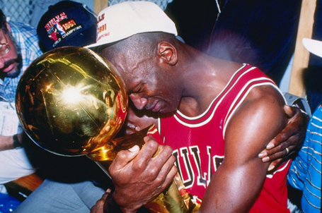Series_mvp_and_guard_michael_jordan_of_the_chicago_bulls_hugs_the_championship_trophy_as_the_bulls_defeated_the_los_angeles_lakers_25252c_1991_medium