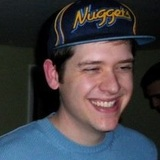 Me_laughing_in_blue_sweater_and_nuggets_hat2