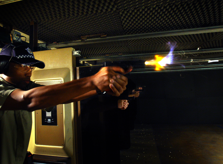 police officer shoots gun in training