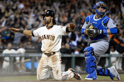 Giants hector Dodgers in extras, walk off in 12th