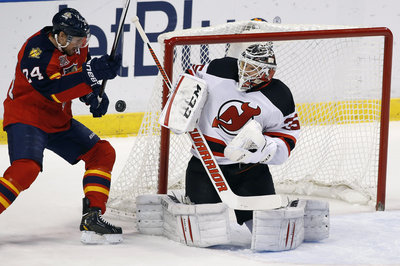 Bumbling Panthers get blasted 5-1 by Devils in home-opener