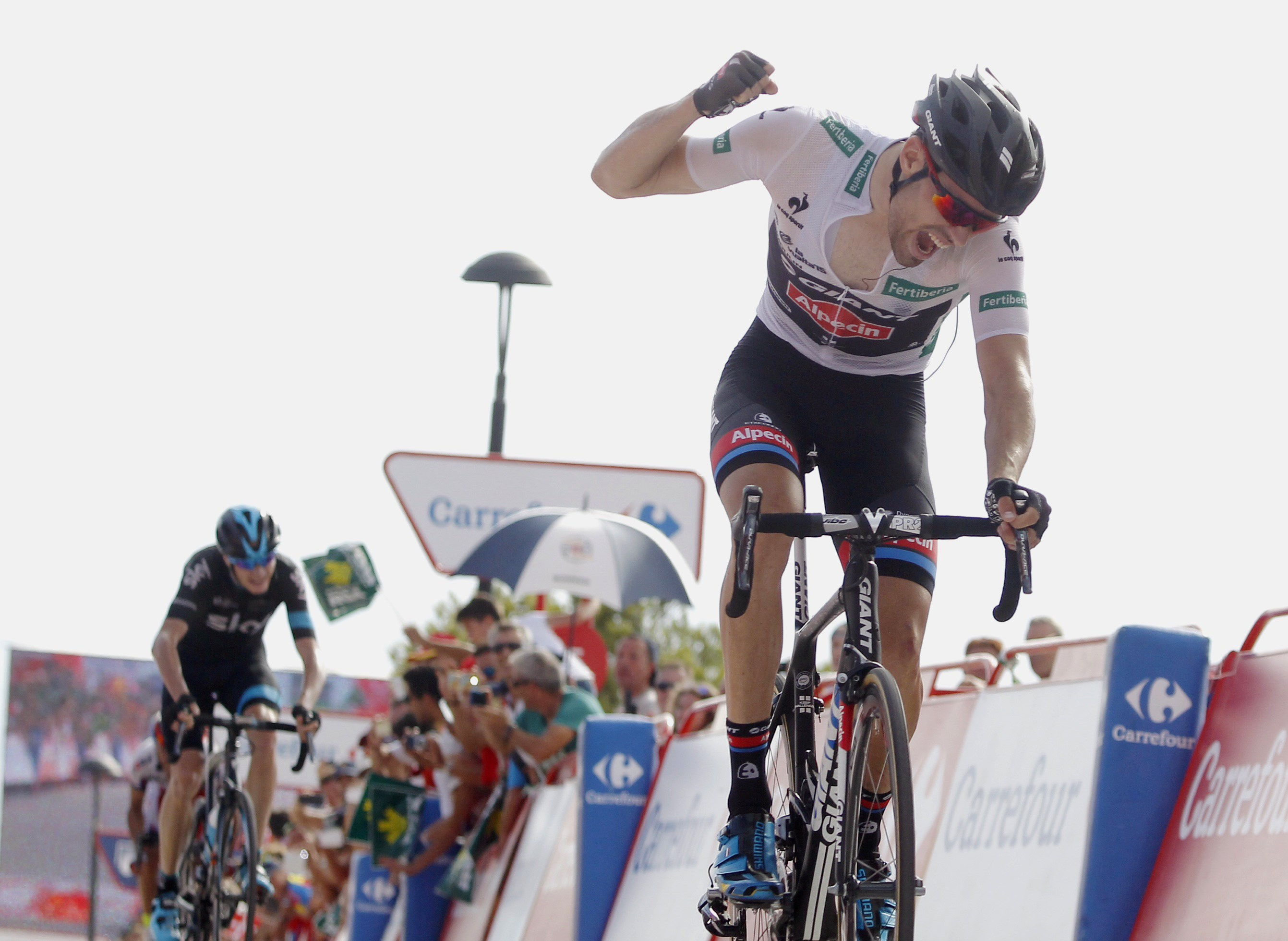 Thumbnail: Dumoulin punches the air after winning stage 9. - JOSE JORDAN/AFP/Getty Images.