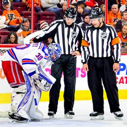 Ref and linesman check on Lundqvist who was in pain after being hit by own teammate during the third.