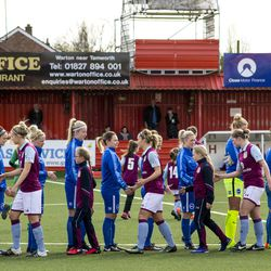 The teams shake hands before the match.