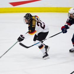 Team Germany defenseman Tanja Eisenschmid moves the puck up the ice.