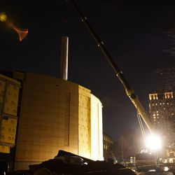 One of the painting rolls is hoisted into its new Buckhead home.