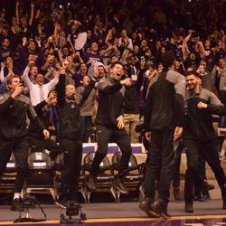 Bryant McIntosh leaps into the air to celebrate Northwestern's selection as the No. 8 seed in the West.
