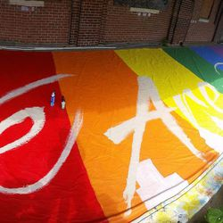 """Adding the """"We Are One"""" lettering to the tifo"""