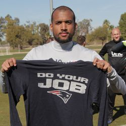 """Teal Bunbury flashes a Bill Belichick """"smile"""" while displaying his signature Do Your Job tee."""