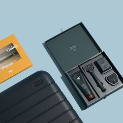 """Away <a href=""""https://www.awaytravel.com/fathers-day"""">Father's Day Gift Set</a> (Carry-on Suitcase, Harry's Razor Set, and Book), $245"""