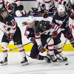 Team USA and Team Canada collide.
