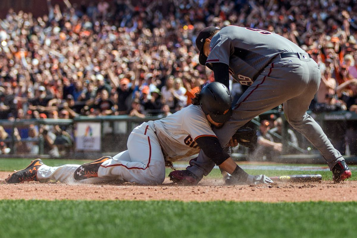 Giants' Posey struck in head by pitch, leaves game