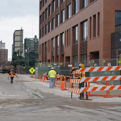 Due to the pavement work being done, Waveland Avenue is reduced to one lane, in front of the plaza building