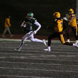 Sergio Bailey II during a run after a catch.<br>