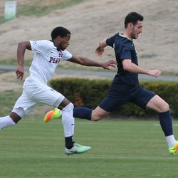 Javi Perez on the ball with Jerel Blades giving chase