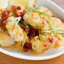 Cod cheeks with crispy ham and vinegar peppers