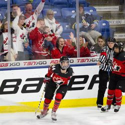 Team Canada forward Sarah Potomak celebrates her first period goal.