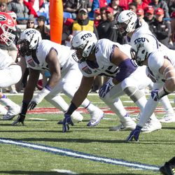 The TCU defensive line gets ready to attack.