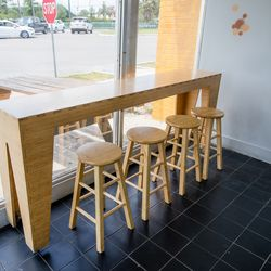 Not a lot of seating at MCP Uptown, other than a few stools to enjoy a slice. Take-out and delivery available.