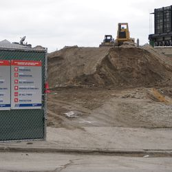 View showing the mound of excavated dirt, in the Addison Park project, along Addison Street