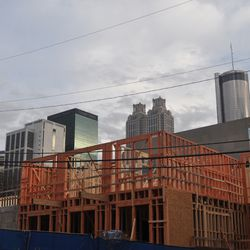 The downtown skyline beyond the construction along West Peachtree Place.