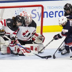Team Canada defenseman Laura Fortino clears the puck.