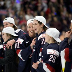 Team USA forward Meghan Duggan and Team USA forward Hilary Knight celebrates winning the gold medal.