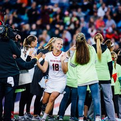 Dempsey Arsenault gets high fives from fans during the team introductions