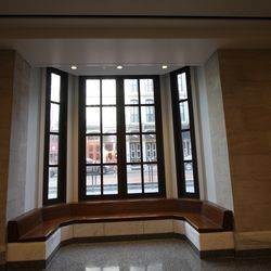 A built-in bench in the lobby of the museum looks out to Chestnut Street.