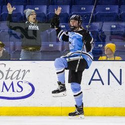 Buffalo Beauts Forward Corinne Buie is pumped after scoring what would end up be the game-winning goal of the Isobel Cup Finals against the Boston Pride. Emotions spill over into the group of NWHL fans seated in the front row.