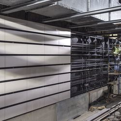 Installation of the wall tiles at 96th Street, circa 2016