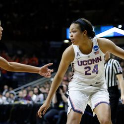 UConn's Napheesa Collier (24) looks to get past a Syracuse defender.<br>
