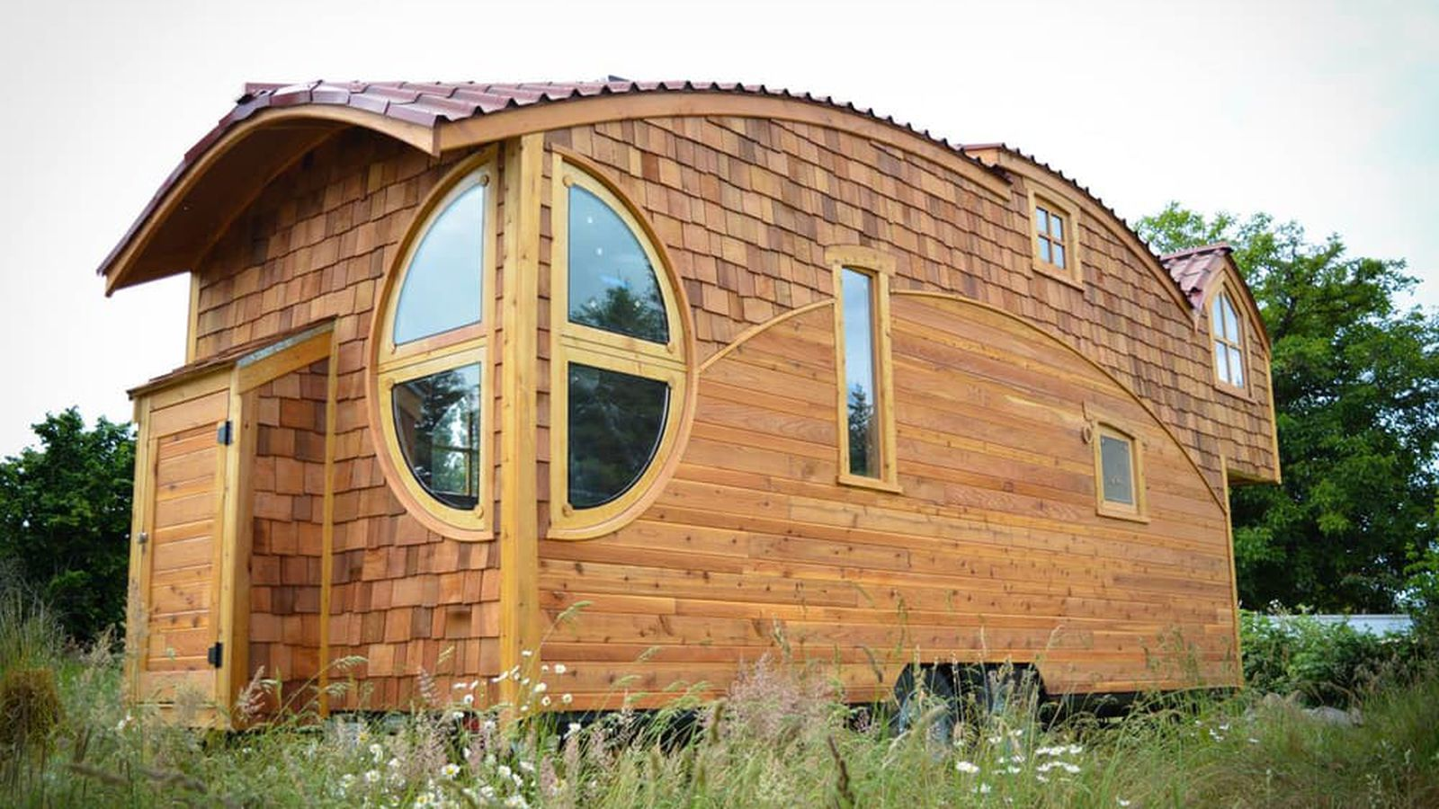 New Tiny House Lives Large With Extra-High Ceiling and Fun ...