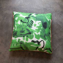"Electra Eggleston <a href=""https://www.wilderlife.com/electra-eggleston-havana-verde-22-pillow-with-red.html"">Havana Verde Pillow,</a> $280"