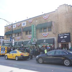 The line outside of Sluggers, on Clark Street. Note the city ambulance on a call, parked outside