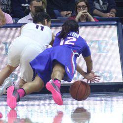 UConn's Kia Nurse (11) dives for a loose ball.