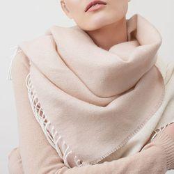 "Cuyana <a href=""https://www.cuyana.com/shop/accessories/scarves.html"">Two-Tone Baby Alpaca Scarf</a> ($150)"