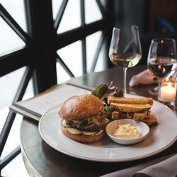 Burger with caramelized onions, comté, and frites