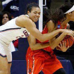 UConn's Napheesa Collier (24) ties up a Syracuse player.