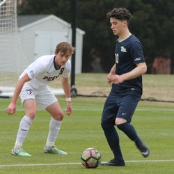 Marcony Pimentel on the ball for Pitt with Gavin Barger defending