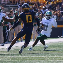 Antoine Porter tries to elude a Toledo defender after a catch.<br>