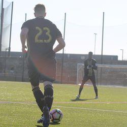 Defender Brandon Golden passes the ball back from the left wing