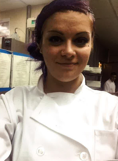 Jessica Goense, dressed in chef's attire.