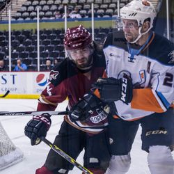 <strong>Eric Selleck </strong>leans in for a heavy check on a Gulls player