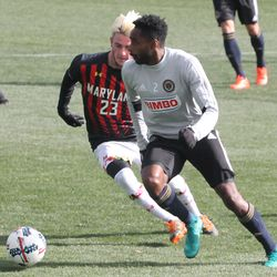 Warren Creavalle moves the ball with Keegan Kelly defending
