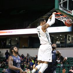 James Thompson with the dunk<br>